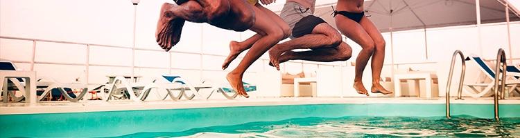 People jumping in pool