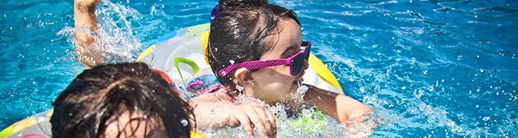 Kids swimming in pool wearing sunglasses